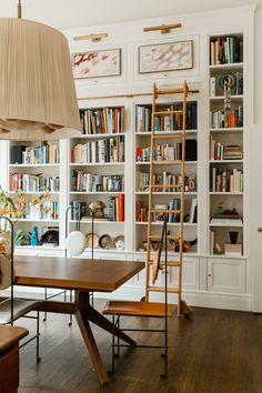 Hirschfeld installed the #bookcase with the ladderwhich has been accented with satin panels from Canadianborn artist...