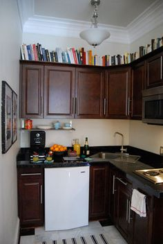 books above kitchen cabinets put a wood shelf so the books will c
