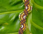 Rust Micro Macrame Bracelet with Purple-Brown and Blue-Gray. $28.00, via Etsy.