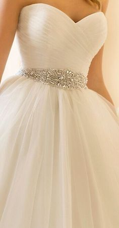 Adorable A-line tulle wedding gown with a simple rouched organza bodice and a gorgeous beaded belt.