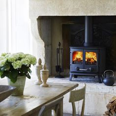 The Morso 2110 is a cast iron multi fuel stove with an heat output. Features include Double doors, large glass windows, radiant heat and an airwash system. Wood, Double Doors, Multi Fuel Stove, Multi, English Design, Morso Wood Stove, House, Spacious, Home Appliances