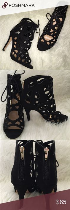 Aldo Dellarocca Sandal This sandal heel by Aldo features tear drop cut outs with a black upper and lace up. A back zipper, gold details and 4 inch heel finish the look. Leather upper, man made sole, worn once, great condition. Aldo Shoes Sandals