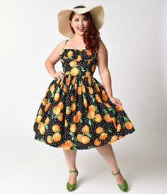 A frock that 'fruits' you well, darlings! A dainty plus size sun dress from Bernie Dexter crafted from breezy lightweight cotton and featuring a vibrant black and orange print surrounded by dainty polka dots, elasticized detailed shelf scoop bust, and hid