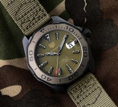Swiss watchmaker Tag Heuer is pushing the camouflage slider all the way to eleven TAG Heuer Aquaracer 300 Caliber 5 watches for Baselworld Army Watches, Gents Watches, Sport Watches, Cool Watches, Rolex Watches, Watches For Men, Camouflage, Tudor Black Bay, Tag Heuer Glasses