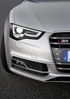Easy on the eyes, but don't think she's only a pretty face. Inside is a 333hp high revving heart of gold, 2013 Audi S5.