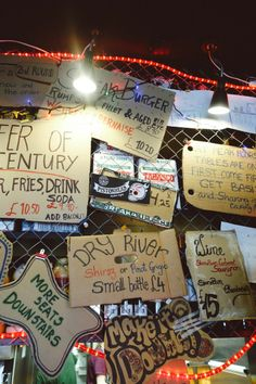 Cardboard Sign Montage -  Tommi's Burger Joint, Chelsea - The Londoner