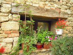 A window of my home.Asciano, Crete Senesi, Siena,Toscana, Tuscany