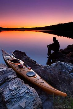 Still water sunset with sea kayak