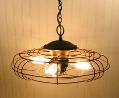 Vintage Fan Cage to transform lighting...love it!!!   Mod Vintage Life