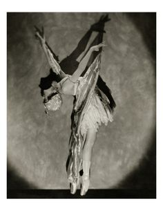 Dorothy Dilley in 'Butterfly Dance,' featured in the 1923 production of Irving Berlin's Music Box Revue. Dilley, attired in a glittering costume complete with wings and antennae, executes a graceful backbend in Nickolas Muray's photograph, from the December 1923 Vanity Fair.