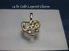 """14 Kt Gold Layered Heart Charm with """"Love"""" Spelled Inside"""