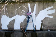 Artist Michael Owen painted his first Baltimore Love Project mural in Mount Washington