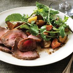 Roast Beef with Root-Vegetable-and-Green-Peppercorn Salad | Brined green peppercorns aren't particularly popular, but Kristin Donnelly loves them in a dressing for sweet roasted fall vegetables and roast beef.