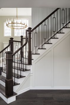 We kept the entryway simple but paneled the wall beneath the stairs to add some texture and to tie into the elegant dining room we designed immediately next to it. Wood Staircase, Grand Staircase, Staircase Design, Staircases, Stair Design, Railing Design, Door Design, Oak Bathroom, Bathroom Interior