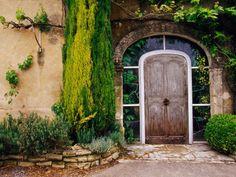 Google Image Result for http://cache2.artprintimages.com/p/LRG/27/2755/BV9TD00Z/art-print/tom-haseltine-greenery-surrounding-wooden-door-provence-france.jpg
