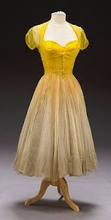 """This is a Debbie Reynolds dance costume worn by her in the MGM musical """"Give a Girl A Break"""". The gown was designed by Helen Rose in 1953. The dance costume consist of a yellow chiffon top and cream chiffon skirt with multiple ruffled layers of underskirt. The gown is used in a dance sequence with the legendary dancer and choreographer Bob Fossee."""
