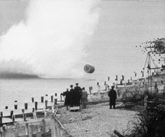 """""""Practice version of the Upkeep bouncing bomb being dropped during a training flight by members of RAF 617 Squadron at Reculver bombing range, Kent. Air Force Bomber, Air Force Aircraft, Ww2 Aircraft, Lancaster Bomber, Royal Air Force, World War Two, Wwii, Things That Bounce, Beach"""