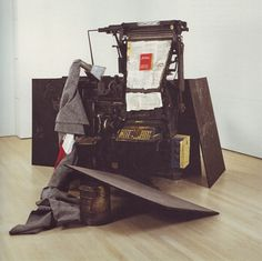 Terremoto, Joseph Beuys; 1981  (Typesetting machine with fat, Italian flag wrapped in felt, chalk on nine   blackboards, metal container with fat and lead type, recorder with cassette and printed brochure)  www.artexperiencenyc.com