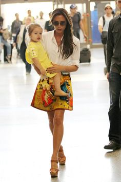 Victoria Beckham carrying Harper at LAX - celebrity fashion