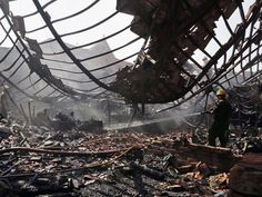 A firefighter hoses down debris after a blaze at the fish and vegetable section of Sir Stuart Hogg Market in Kolkata, India. No casualty were reported.  Bikas Das, AP