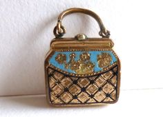 Antique Victorian Purse Locket Miniature Handbag Charm. $160.00, via Etsy.