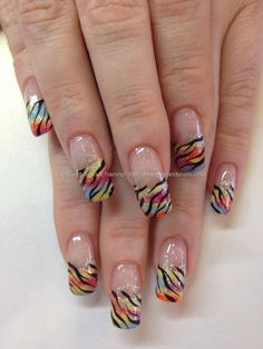 Multi coloured tips with black zebra nail art over acrylic nails