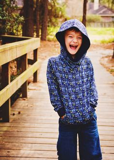 Super comfy and oh so cosy, the Comfy Cowl Hoodie PDF Sewing Pattern has an optional front pocket and is perfect for both boys and girls. Includes sizes newborn to 12 years.