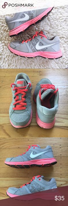 Hot Pink + Gray Nike Tennies Gray Nike shoes with hot pink accents. Shoes are worn. Very comfortable, great for running or working out. Nike Shoes Athletic Shoes