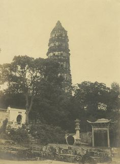 """In the 1920s:  Tiger Hill Pagoda at Yunyan Monastery in Suzhou, China - built in 960 AD.  •  This seven-story, octagonal-shaped pagoda sits atop """"Surging Sea Hill.  •  Credit: ccaprojects.org Peter Shay"""
