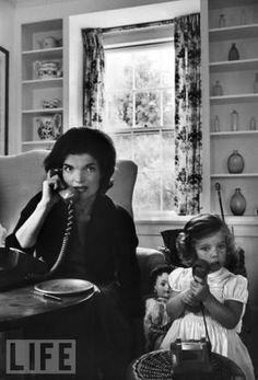 jackie bouvier kennedy onassis with caroline on the phone.jpg