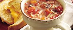 Fire-roasted tomatoes bring robust flavor to tomato soup loaded with orzo pasta and vegetables.
