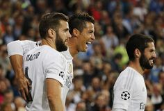 Cristiano Ronaldo of Real Madrid celebrates with Nacho Fernandez and Isco after scoring their team's fourth goal during the UEFA Champions League...
