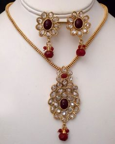 Antique Gold plated necklace with pendant embedded with oval shaped fuchsia and clear crystal stones-20ATQP  http://www.craftandjewel.com/servlet/the-1285/Antique-Gold-plated-necklace/Detail