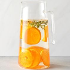Who doesn't love the bright and juicy flavor of tangerine? The addition of thyme really rounds out this infused water. —James Schend, Taste of Home Deputy Editor Best Flavored Water, Cucumber Infused Water, Flavored Water Recipes, Drink Recipes, Mint Water, Spa Water, Fruit Water, Digestive Detox, Lemon Diet