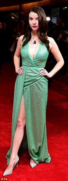 Gorgeous in green: Anya Taylor-Joy wowed in a dazzling green dress with a thigh-high split
