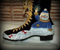 Hand painted Christmas Double-sided Snowmen and Greenery Ice Skate Decoration. $49.00, via Etsy.