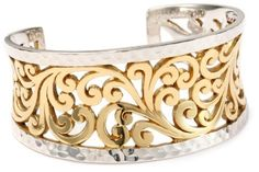 """LOIS HILL """"Two-Tone Open Scroll"""" Medium Cuff LOIS HILL. $448.00. Detailed with 24k Gold-plating. Detailed with 24k Gold-plating Made in ID. Made in Indonesia. Our mission at Lois Hill Accessories is to bring cultural and artistic richness to your life - one piece of jewelry at a time.. A technique that dates back to prehistoric times, this elaborate hand carved scroll is created with the use of chisel and hammer"""
