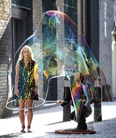 SamSam Bubbleman, otherwise known as Sam Heath, has been impressing onlookers around London by practising his unique 'sculptures' out of soapy water. Mr Heath holds nine world records, including the world's biggest bubble measuring 500 cubic feet, fitting 50 people inside one bubble and creating 56 bubbles inside another. via dailymail.co.uk