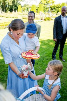 Prince Daniel of Sweden Crown Princess Victoria of Sweden Princess Estelle and Prince Oscar of Sweden is seen meeting the people gathered in front of...