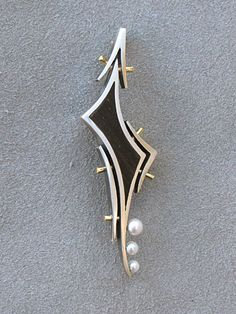 brooch in silver and gold with ebony and pearls by George Brooks of Santa Barbara, California circa 1972