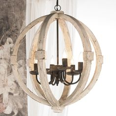"""White Washed Wood Sphere Chandelier Rustic iron and distressed wood go well together in any shape or form and this sphere chandelier is no different. The distressed white washed wood finish and rustic iron accents complement as well as contrast one another. A combination you cannnot go wrong with! 6X40 watt candle base lamps max. (26""""Hx22.5""""W)"""
