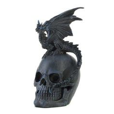 "A commanding accessory for your lair, this finely detailed dragon rests majestically upon the spoils of battle from ages ago. His gothic wings, spiny tail and large claws demonstrate his untamable nature to all creatures who gaze upon him.   Item weight: 1.6 lbs. 5 3/8"" x 6½"" x 9¾"" high. Polyresin"
