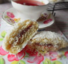 Scottish Snowball Cakes - Dropped sponge cakes, sandwiched together with raspberry jam, coated in a glace icing and then rolled in dessicated coconut. A bit fiddly, but so worth the effort for a special occasion - Marie of TEK