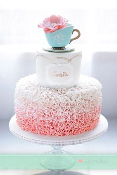 Teacup topper on a ruffled ombre wedding cake!