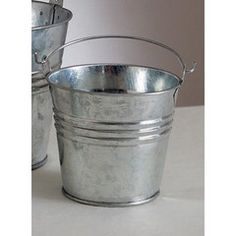 Galvanized Pails - 3.75 Inch tall  For centerpieces? Not sure about the handle.