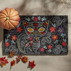 Inspired by the Day of the Dead, our festive doormat offers plenty of reasons to purr. It's crafted of coir, a durable coconut fiber, is easy to clean and is incredibly affordable. Guess the cat's out of the bag.