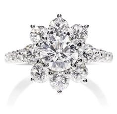 Harry Winston Sunflower Diamond Ring. Sunflower ring with a colorless round brilliant diamond center stone, set in platinum. 17 round brilliant diamonds, approximately 1.65 total carats.