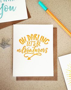 Oh Darling Let's Be Adventurers orange brush lettering by 622press