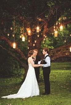 Lanterns hanging from tree wedding altar