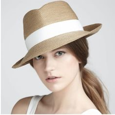 Straw fedora with low ponytail  Cute summer hats should be on every gals list of summer must-have accessories! Throw on your shades and sandals, splash on a bit of lotion and top off a casual summer do with a fabulous hat . . . and you're golden!